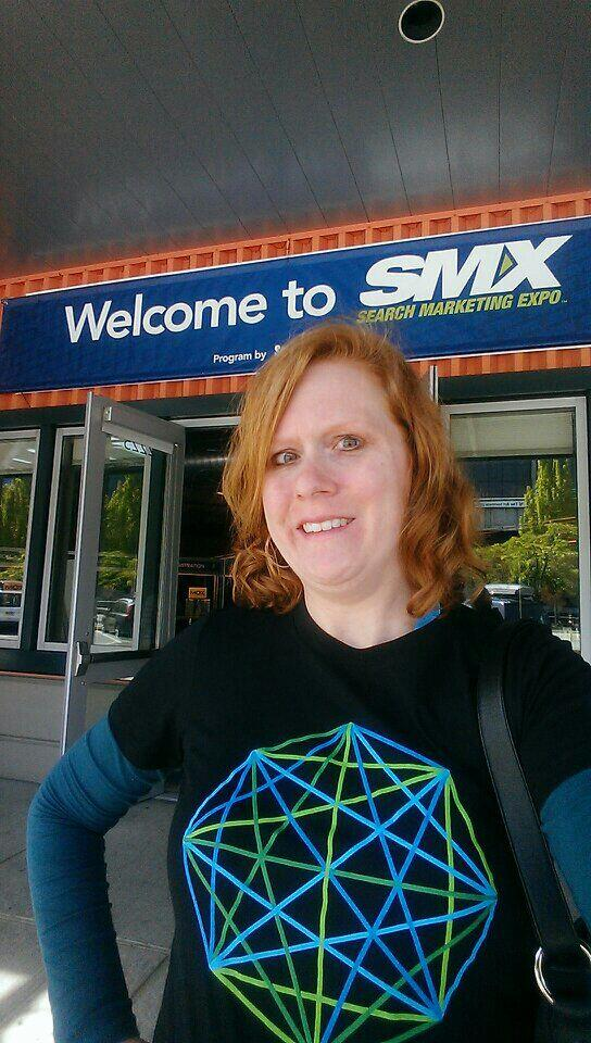 Jeannine strikes a pose in front of the SMX banner. A perfect backdrop!
